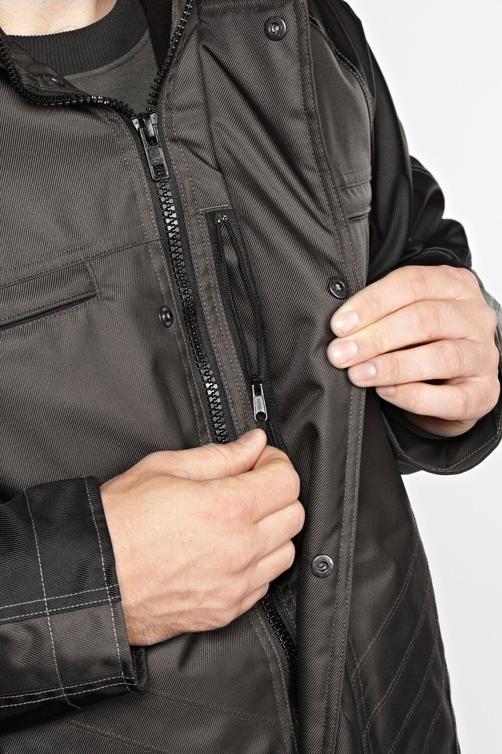 Zipped pocket under storm flap. - 12035-211 - Detail