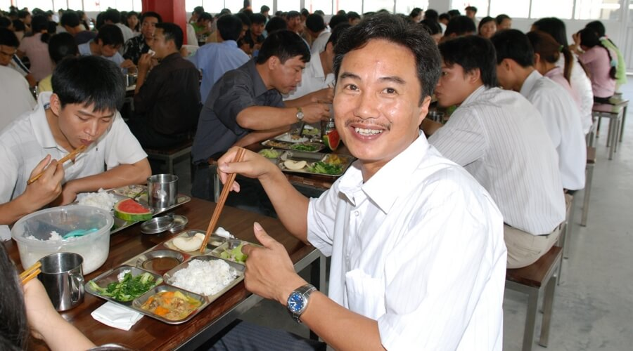 People-eating-lunch-smiling  Own factories in Vietnam: